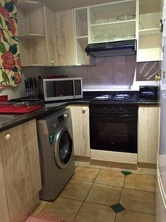 Kitchen with Stove, Microwave, Fridge/Freezer, washing machine, toaster, Kettle and cooking utensil