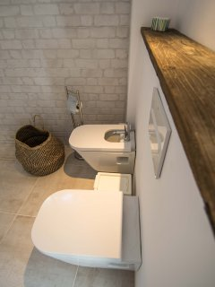 bidet and toilet suspended from the wall.