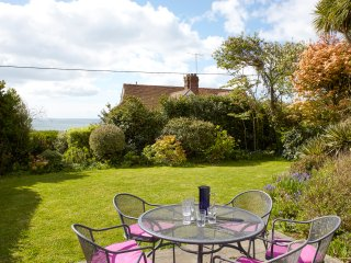 Private garden with mature planting. The deckchairs are kept in the garden shed!