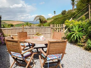 ROSE COTTAGE, end-terrace, woodburner, parking, patio, in Hallsands near Kingsbr