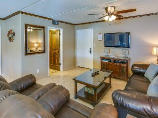 Dog-friendly condo w/ updated finishes, balcony w/ grill, and a shared pool!