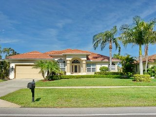 Elegant waterfront house with heated pool and short walk to Tigertail Beach