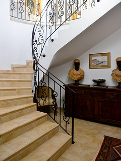 Entrance hall with open plan staircase to TV lounge and bedrooms.