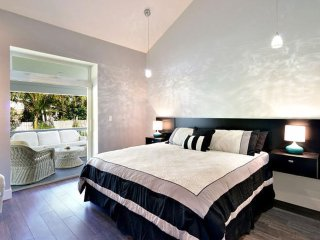 Master bedroom with private access to deck and pool