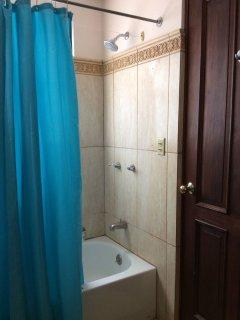 Main bathroom. Bath tube and shower.