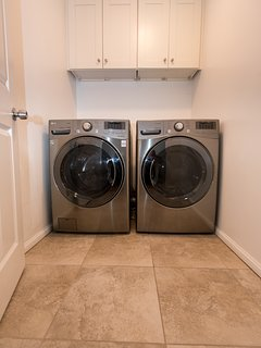 Laundry Room, new LG large capacity washer & dryer. Stone tile floor