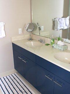 The master bathroom has a double sink vanity.