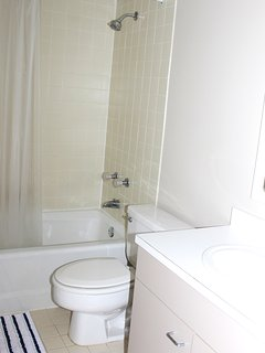 The 2nd bath has a shower/tub and is accessible from the hall.