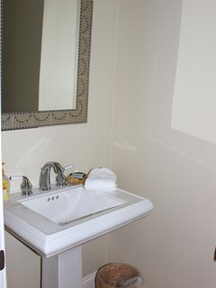 Off the living area is a powder room.