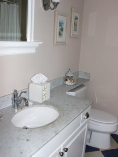 The hall access bath has been updated & has a granite vanity top & tub/shower.
