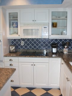 There is plenty of counter space for preparing meals.