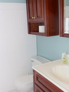 The master bath has been updated and has wainscot paneling.