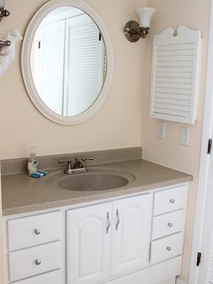 The large vanity makes it easy for two to get ready for their day.