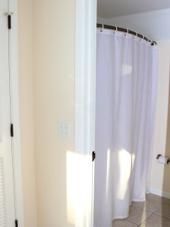 In a separate room is a shower/tub.