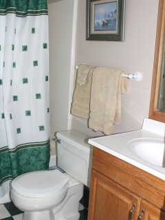 The full bath has a shower/tub combo.
