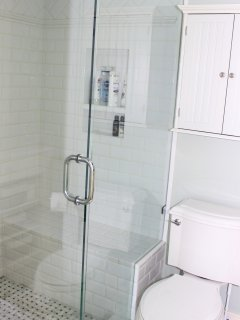 There is a walk in shower for your use.