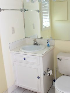 It has tile flooring and a shower tub.