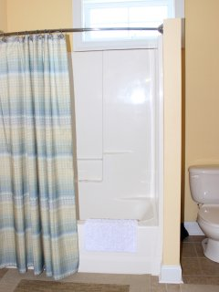 The shower and toilet are in a separate room.