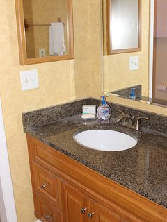 The master bath has an extended granite countertop.
