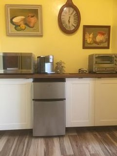 Lovely kitchenette with all new appliances. And enjoy  BBQ on the gas grill right outside your door
