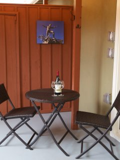 Enjoy a glass of wine or morning coffee on the covered patio.