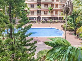 Sumptuous 2-Bhk apartment with a pool, 1 km from Candolim beach