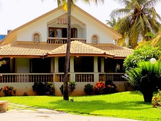 4BHK Portuguese pool villa surrounded by lush greenery