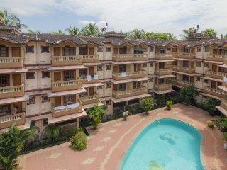 Elegant 2-bedroom apartment with a pool, near Candolim Beach
