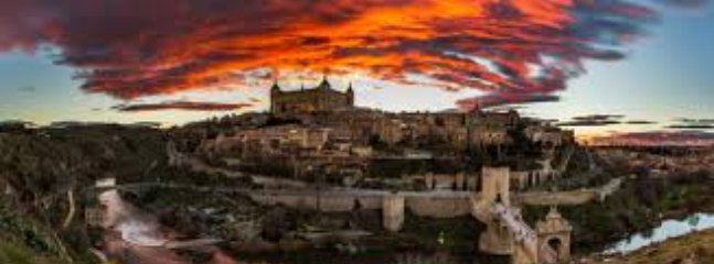 Toledo, surrounded by the wall and the Tagus River