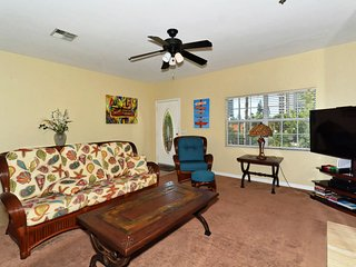 Large spacious living room with large flat panel HDTV, fireplace