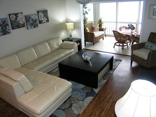 Spacious living room with view out to Lanai, the beach and azure waters of the Gulf of Mexico...large HDTV, stereo, and more...