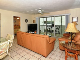 Spacious living room with walkout to the lanai - large HDTV, leather couch/loveseat