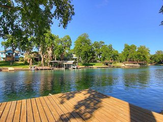 Riverfront 4 bedroom home! Sleeps 14 with lots of outdoor living space!