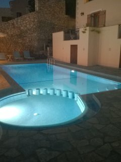 The pool is illuminated in the evening ready for a late dip.