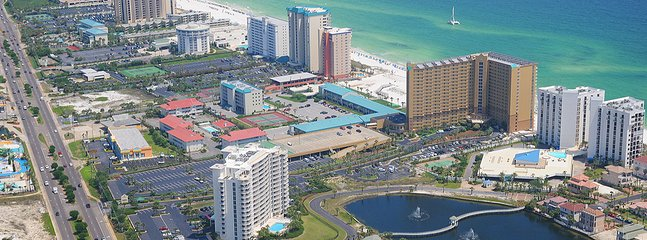 We are right on the beach. Pelican is the brown L-shaped building..
