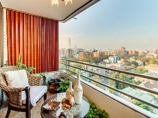 Elegant upper-level condo with shared pools and sauna, stunning city views!