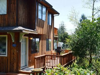 Entrance into Little Apple Cottage.  South facing ocean view deck with a patio table for 4 and a new Gas BBQ