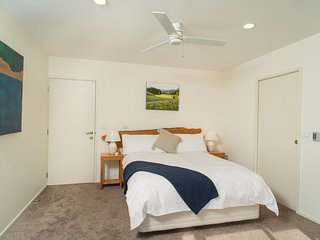 Queen bedroom, ensuite, ceiling fan. seaviews from bed, real art on walls