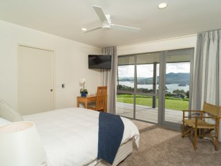 Queen Ensuite, separate WC, seaviews, direct deck access, afternoon sun side, Whangaroa