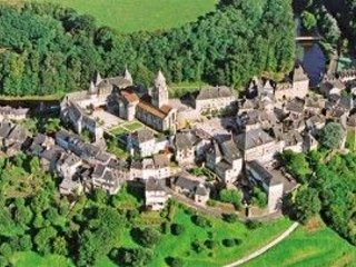 Aerial view of the old town of Uzerche set within the meandering River Vezere.