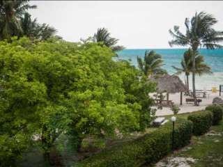 **Spring Discount** Sandy Beach & Boat Dock at this Tropical Beachfront Townhous