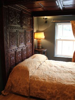 The beautifully carved Tudor style four poster bed