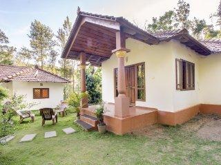 Traditional cottage amid lush greenery, near Raja's Tomb