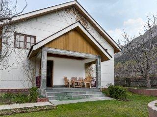 2-bedroom cottage nestled in a hilly landscape