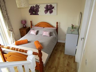 Lovely downstairs bedroom with underfloor heating,  patio doors  lead out to  private courtyard.