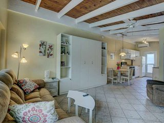 Efficiency Villa On Private Beach with Murphy Beds, Wifi Included, Front Yard &