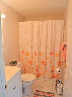 Clean private bathroom next to living space