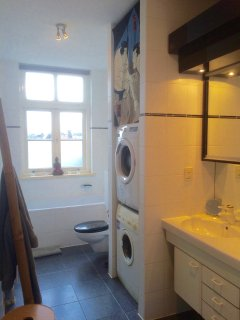 The bathroom has a two sinks, a large tub, separate shower, and a washer and dryer.