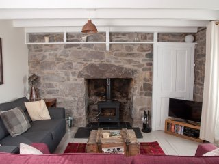 Large sofas and logburner