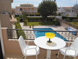 Lovely 2-bedroom flat with balcony and pool, close to beaches